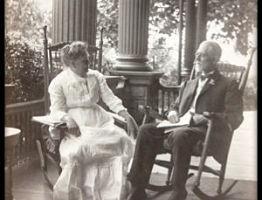 photo of ET and Ella Frampton Kurtz sitting on porch of their house