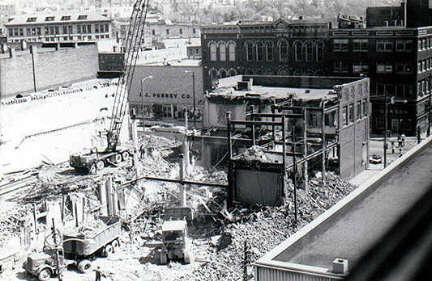 Destruction of downtown buildings including Lawrence Savings and Trust