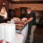 Freddie Faraone, Farone Catering with ready to go meals in the dining room