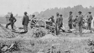 photo of Battery B men standing with canon