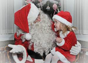 photo of little girl with santa claus