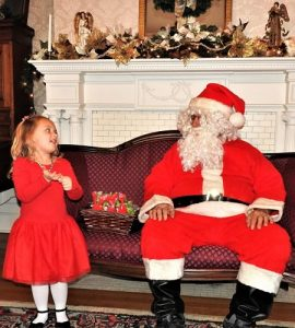 photo of young girl talking with santa claus