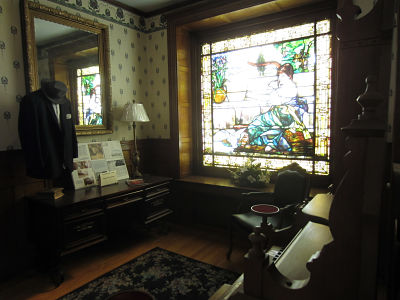 photo of upper hall with 7 foort stained glass window