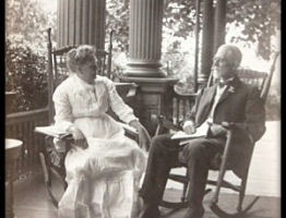 photo of ET and Ella Frampton Kurtz sitting on porch of their house