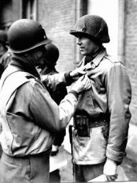 wwii soldier receiving medal from officer