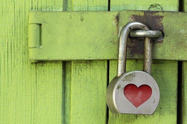 large padlock on wooden door